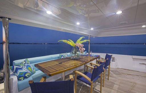 main deck aft with alfresco dining on board luxury yacht 'Lady Carmen'