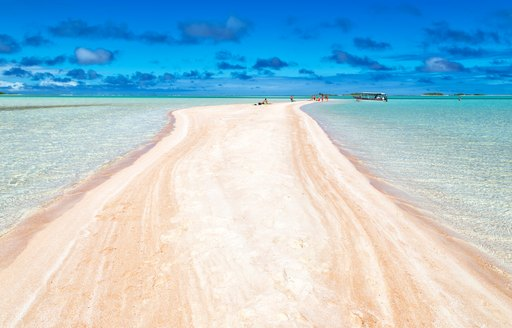 Long stretch of white sand in Tahiti