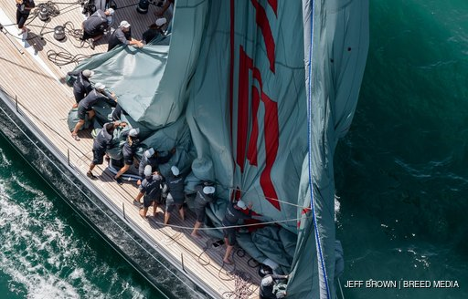 sailors on deck of superyacht during nz millenium cup
