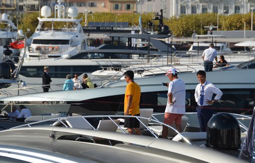 People tour a yacht at Cannes Yachting Festival