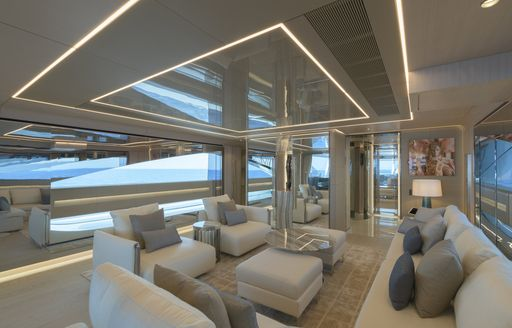 Comfortable pale seating and interior on superyacht EIV