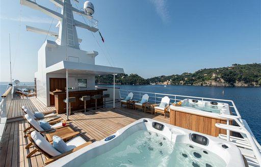 Sundeck including Jacuzzi on superyacht Bleu De Nimes