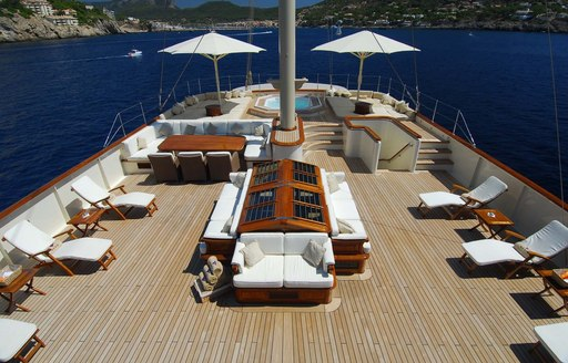 expansive sundeck with loungers, seating and Jacuzzi aboard motor yacht NERO