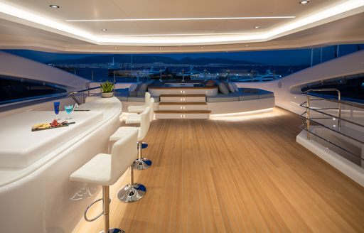 Bar area on superyacht O'PARI with Jacuzzi in background and teak decking visible