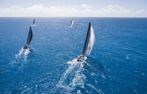 yachts cut through the sparkling waters at the RORC Caribbean 600