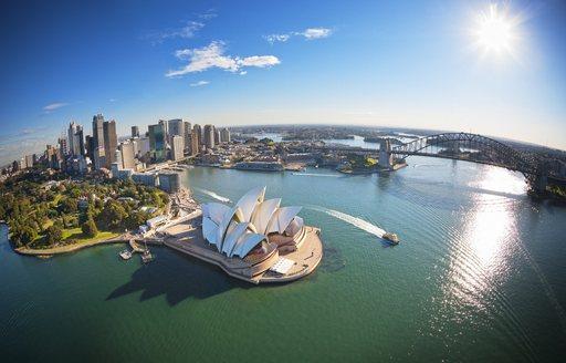 Aerial shot of Sydney Opera House and Harbour Bridge in Port Jackson