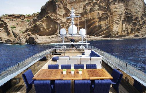 Sun deck area with dining al fresco aboard luxury yacht BLADE