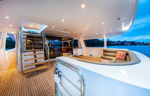 comfortable sofa on main deck aft of charter yacht CORROBOREE