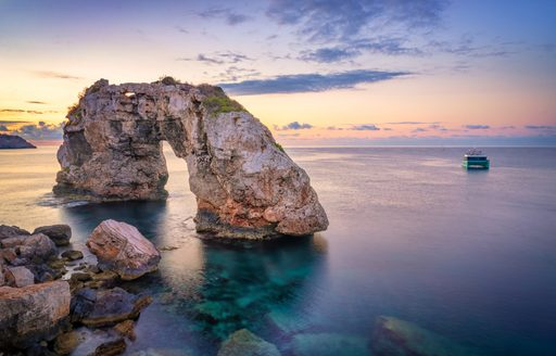 rocky outcrop in water in the balearics