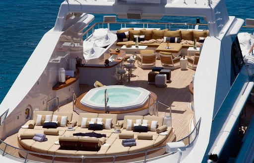 sun pads, Jacuzzi, bar and large seating area on sundeck of superyacht Helios