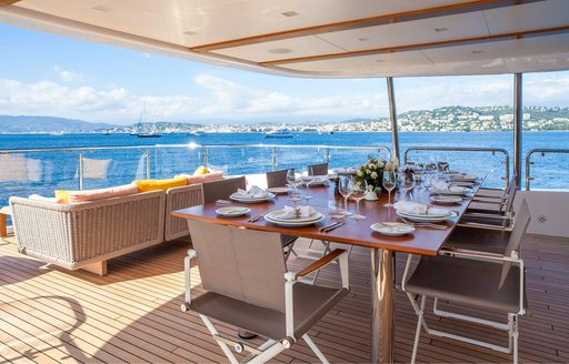 alfresco dining and seating areas on the upper deck aft of motor yacht DYNAR