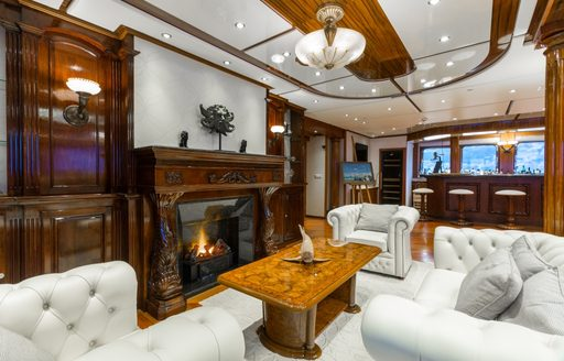 Fireplace and seating area on luxury yacht LEGEND
