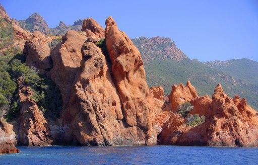 spectacular orange rock formations of Scandola National Park in Corisca