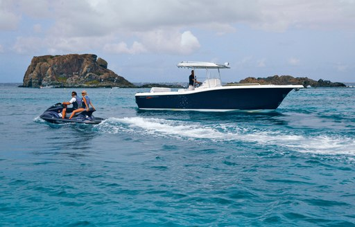 Charter guests on luxury yacht Zoom Zoom Zoom's  jet ski and tender