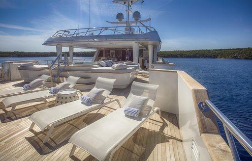 Sun loungers on board motor yacht KATINA