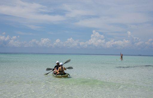 women kayaking around the shallows of thanda island