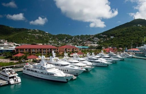 A collection of white superyachts docked in St Martin Marina