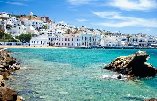 Blue water lapping shore of charter destination of Greece