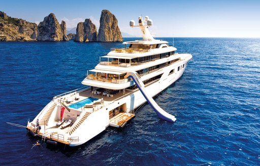superyacht aquarius on her charter season through the Mediterranean with all of her water toys and, swim platform, and beach club on display