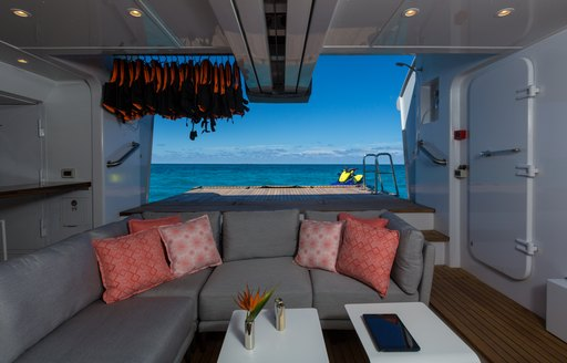 Sofa with beach club behind on Superyacht BACA