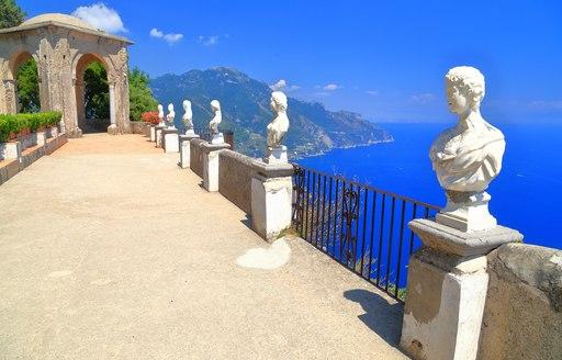 Open terrace and classical statues in the sun, Ravello, Amalfi coast, Italy