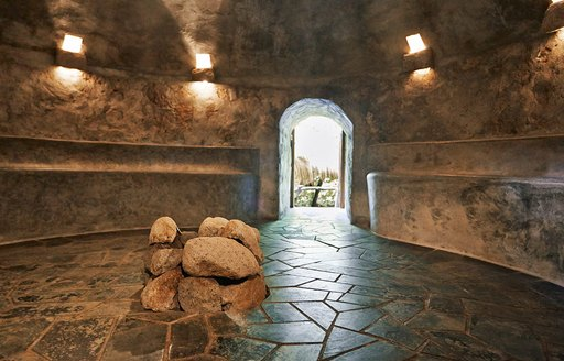 A collection of rocks assembled inside a stone spa structure