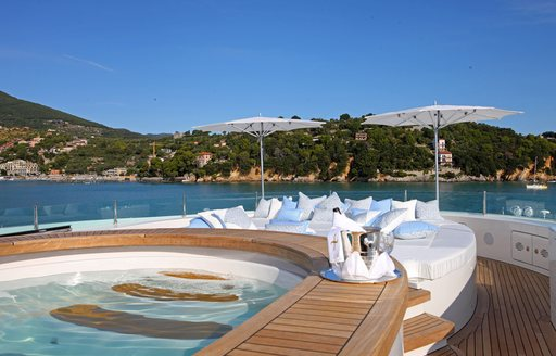 jacuzzi and sun pads on sun deck of luxury charter yacht st david
