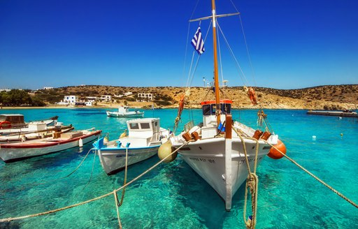 small fishing boats on the water in harbour in greece