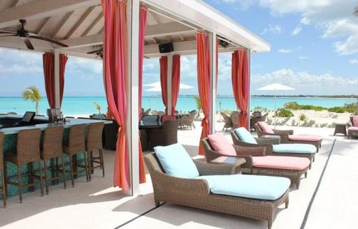 outdoor seating at bahamas restaurant treasure sands club