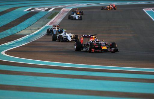 Cars rounding corner of Yas Marina race circuit