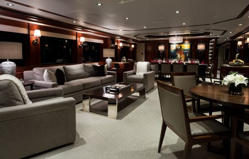 Grey furnishings and wood finishings found in the interior of superyacht W