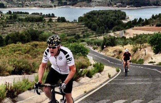 cogs for cancer bike rider training on mountainous coast of spain