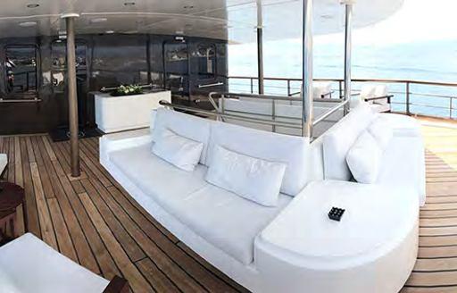 Large comfortable white sofa on Superyacht CHAKRA