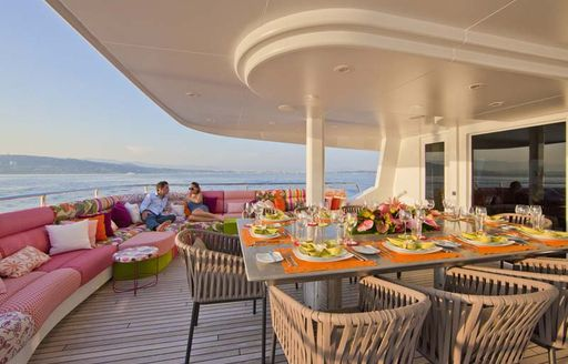 superyacht daloli exterior dining table and sofa seating