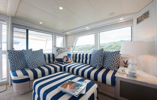 small snug with comfortable sofa on board superyacht DREAMTIME