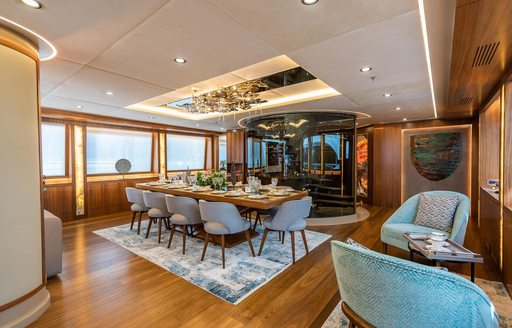 Interior dining area on luxury charter yacht ARESTEAS, with chandelier on ceiling