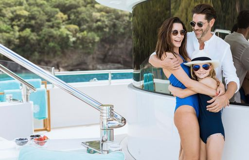 family of charter guests on luxury yacht charter during coronavirus