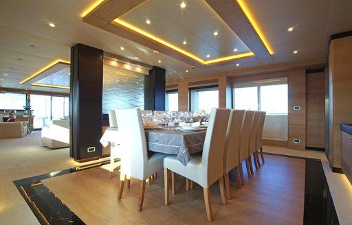 formal dining area in the main salon of motor yacht TATIANA