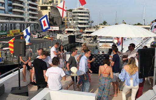 people on board luxury yacht during monaco grand prix