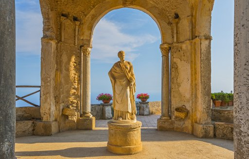 the famous statue of someone in vila cibrone a vacation hostspot that sees masses of guests on a luxury yacht charter through italy come and visit