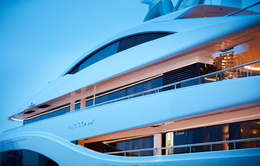the side profile of superyacht arrow in the Mediterranean showcasing her name