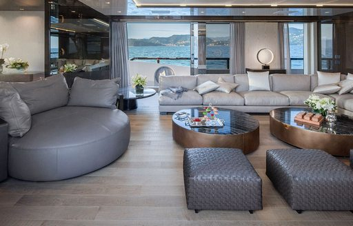 Interior styling and main salon of M/Y A, with sofa seating and coffee tables