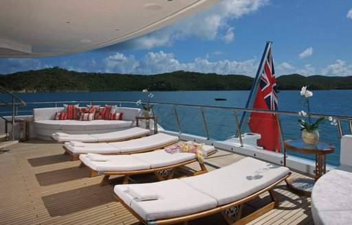 sun loungers in a row on aft deck of superyacht