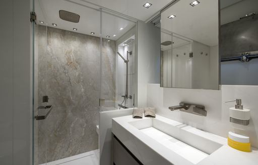 en-suite bathroom with marble shower on board luxury yacht DINAIA