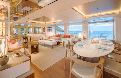 Luxury charter yacht DRIFTWOOD main salon and formal dining table