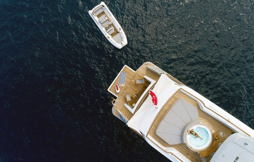 charter guest relaxes in the spa pool on the sundeck of luxury yacht Calypso