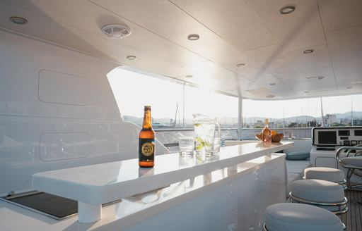 View across covered bar area on board explorer yacht SEAL