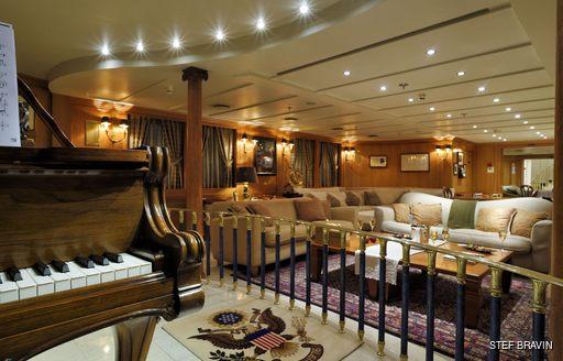 Lounge bar and piano room on superyacht Christina O
