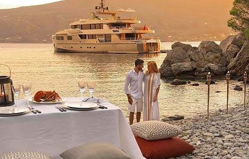 romantic evening meal on luxury yacht
