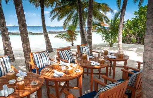 Table set-up on sandy beach in the Caribbean